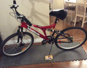 Mountain Bike w Dual Suspension. Brand New used twice. Orleans