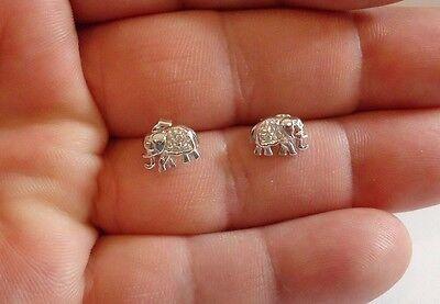(925 STERLING SILVER LADIES ELEPHANT SHAPE STUD EARRINGS W/ .15 CT DIAMOND)