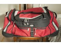 Large Red Holdall with retractable handle