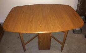 Sovereign oak fold-away dining table with storage