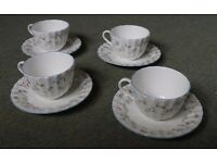 Royal Worcester Forget Me Not - Set of 4 bone china cups and saucers - immaculate
