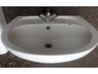 Porcelain basin, with pedestal, drain and mixer tap
