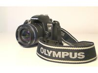 Olympus E-600 digital single lens reflex camera with two zoom lenses and accessories