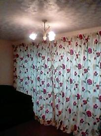 Full length cream and red floral curtains