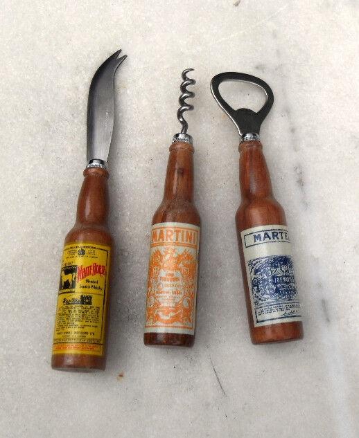 Coffret ancien avec décapsuleur, tire-bouchon, couteau.