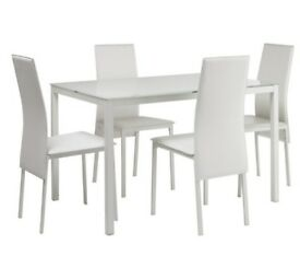 Like new glass dining table and 4 chairs