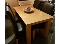 Dining table and faux leather chair (can deliver)