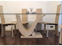 6 Dining chairs + Glass Marble dining table in excellent condition.