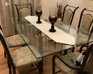 Beautiful glass and wrought iron dinning room table and chairs