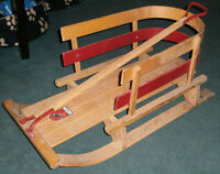 Vintage kids wooden sleigh, a perfect photo prop.
