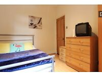 Double Bed in spacious room to rent in house with garden in Tottenham, London