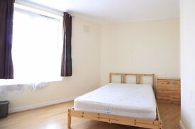 Spacious rooms to rent in a 4-bedroom flat in Greenwich, close to the DLR line