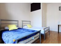Twin Beds in Rooms to rent in a 7-bedroom flat with backyard in Wood Green