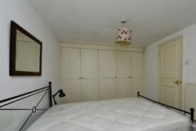 Equipped room with shelving in 3-bedroom flat, Notting Hill