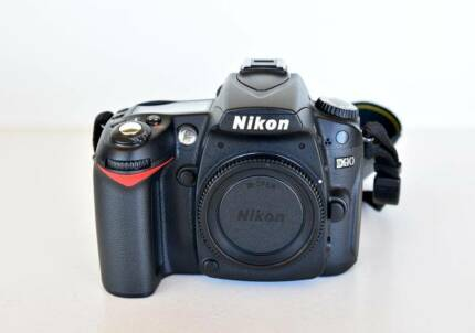 Nikon D90 12.3 MP DSLR with + 18-55 mm VR lens, 4GB card