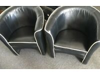 Two Black Leather Armchairs with White Piping