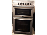 Belling electric cooker, 4 hobs, grill and oven, silver, very good condition.