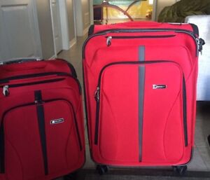 Brand new 2 piece Delsey luggage
