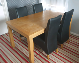 Hardwood dining table with leather chairs