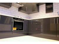 gloss grey kitchen with oven hob hood plus sink and tap