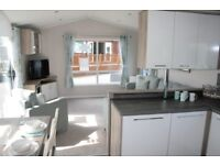 New static luxury family holiday home ,loch side, stunning mountain views, bring the dog and go walk