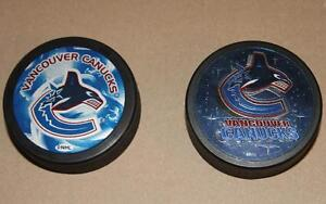Vancouver Canucks two collection pucks