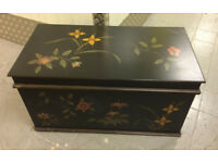 Painted black wooden chest with flower pattern