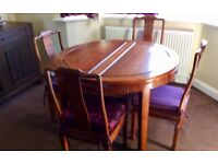 Solid wood Chinese influence table and 8 chairs
