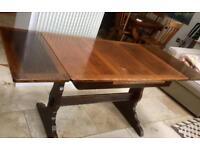 Ercol oak dining table, extendible