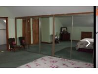 Mirrored wardrobe doors with tracking system