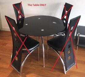 Glass dining table with little fault