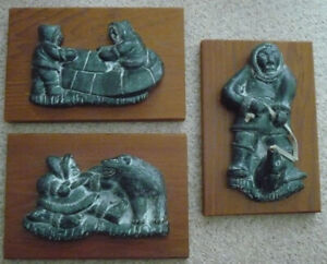 Al Wolf mounted soap stone carvings