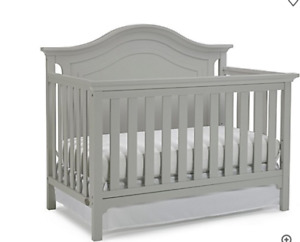 Crib BRAND NEW Ti Amo Crib in Grey. STILL IN BOX