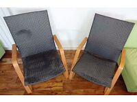 Two elegant yet comfortable modern armchairs in wood and rattan