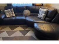 **** Brown leather curved sofa ****