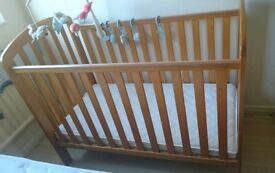 Wooden baby cot in excellent condition