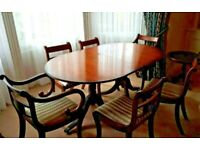 Oval Wood Extending Dining Table And 6 Upholstered Chairs