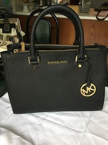 Brand New black Authentic Michael Kors handbag with strap