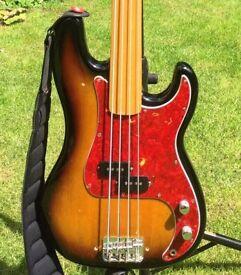 Fender Precision Bass (pbass). 1972 fretless maple neck. Later MIJ body, hardware and electronics.