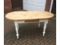 Solid pine table with draw.