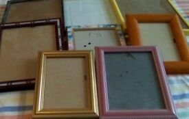 Eight picture frames-two are matching yellow, some have patterns etc.