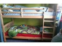 Bunk beds with matresses can be split into 2 single beds