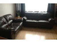 Chocolate brown leather three seater and two seater sofas and a reclining armchair sofa