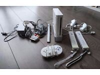 Wii Console with 2 Sets of Controllers and 1 Classic Nintendo Controller