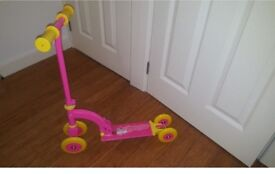 bright pink kids scooter with yellow wheels