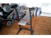 York Weightlifting Bench and assorted weights and bar