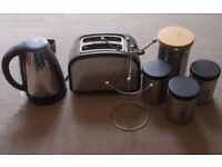 Toaster, kettle, mug tree and kitchen storage set.