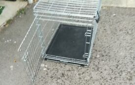 Dog cage/crate medium size. Used for travelling, now outgrown.