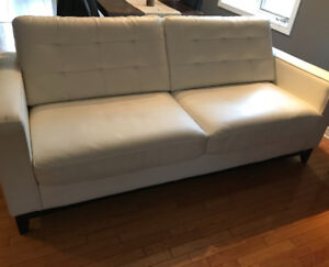 Heavy duty white leather couch
