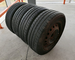 Set of four 175/65/14  all season tires +4x100 rims . 6/32nd